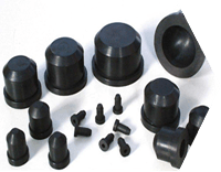 Several black rubber stoppers are displayed, they have different sizes.