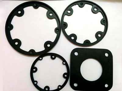 Three round rubber gaskets and one square gasket, each one has evenly distributed pores.