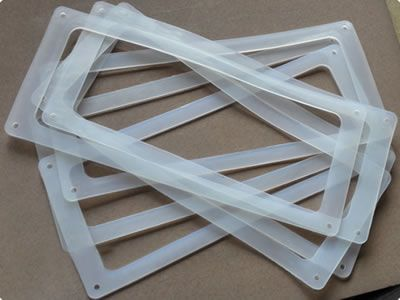 There are several silicone gaskets in rectangular shape, and each corner has one small hole.