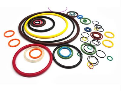 A variety of rubber o rings with different colours and sizes.