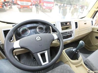 The picture shows the driving cab and we can see the rubber boot installed on the gearshift.
